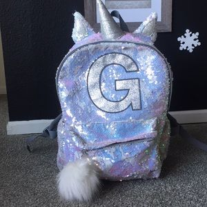 "Sequin unicorn ""Justice"" pack with the letter ""G"""